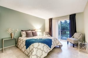 master bedroom with green accent wall