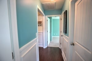 light blue hallway with wainscoting