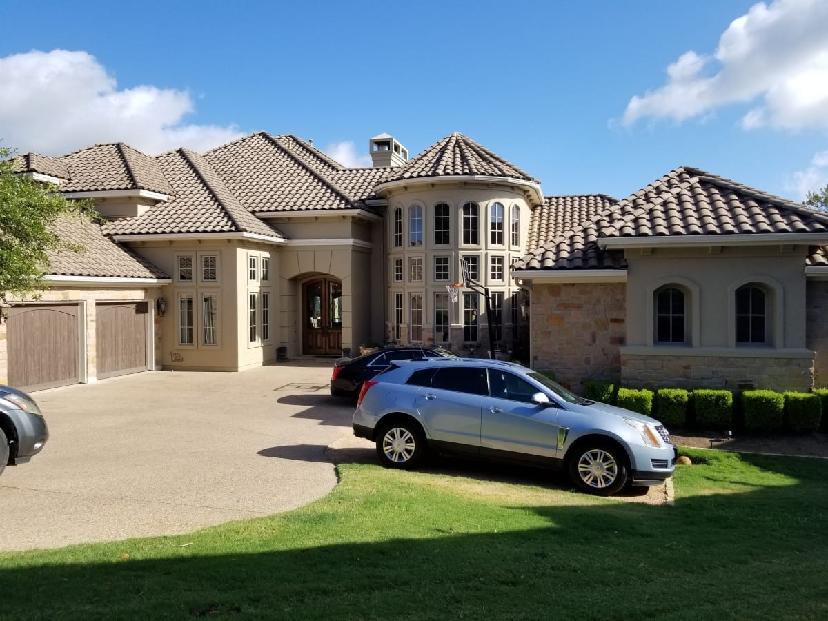 large stucco house painting project - full front exterior