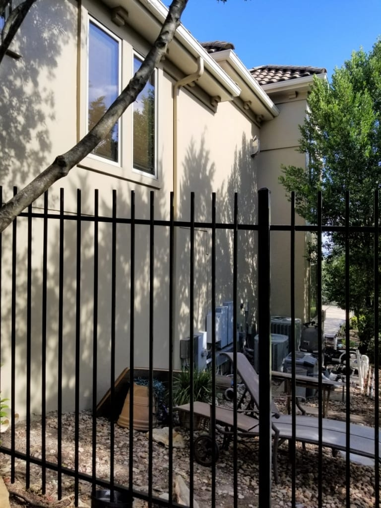 stucco house painting wide with gate