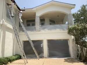 exterior stucco painting on ladders
