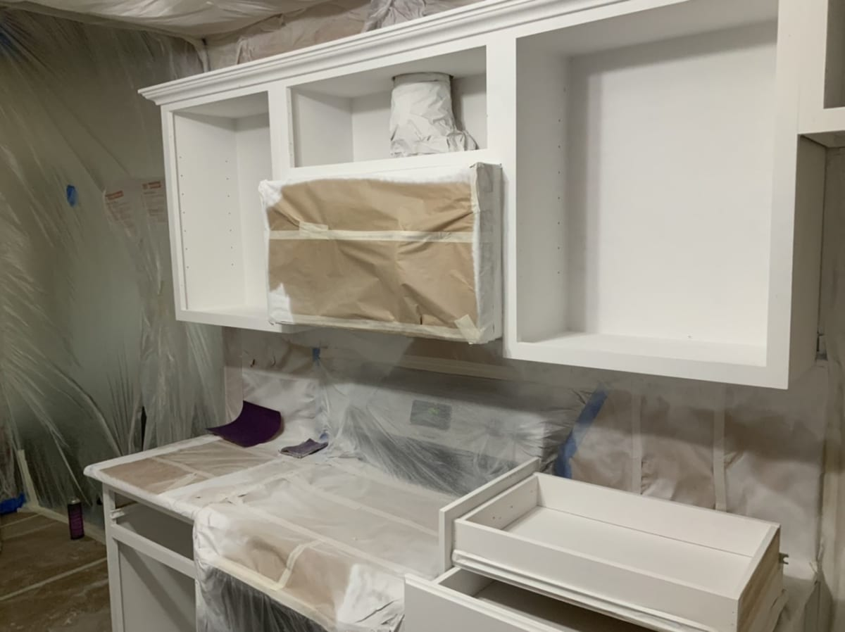 kitchen cabinets prepped for painting