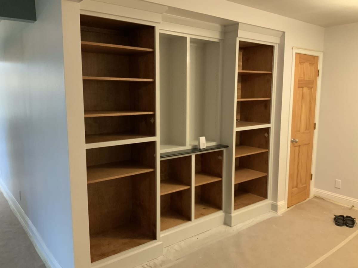painted white built-in living room cabinets