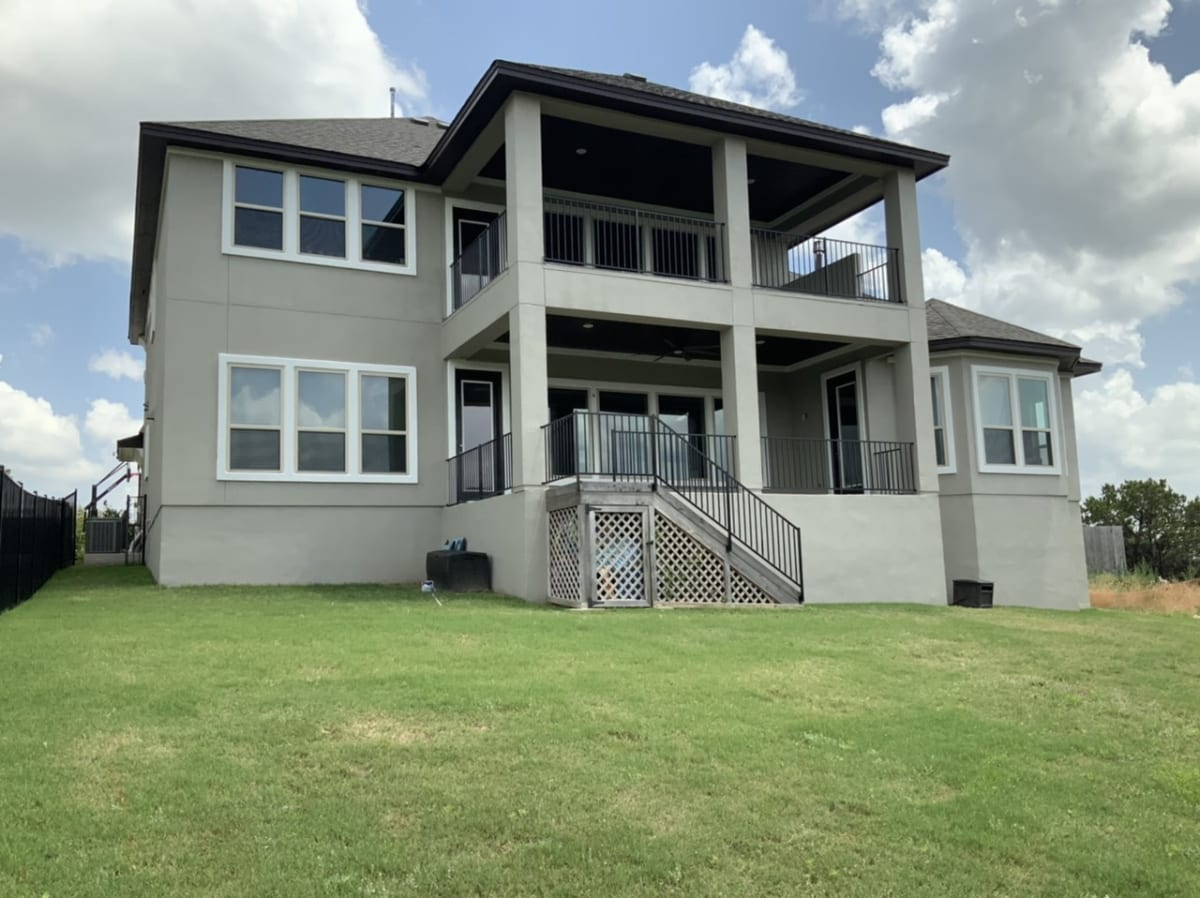 stucco home - full rear view