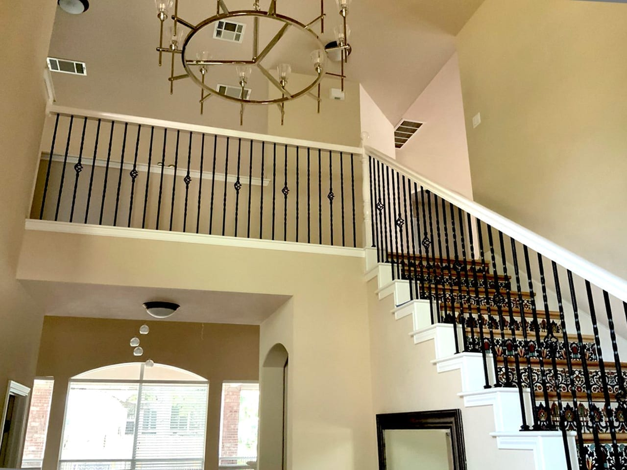 white painted stair handrails