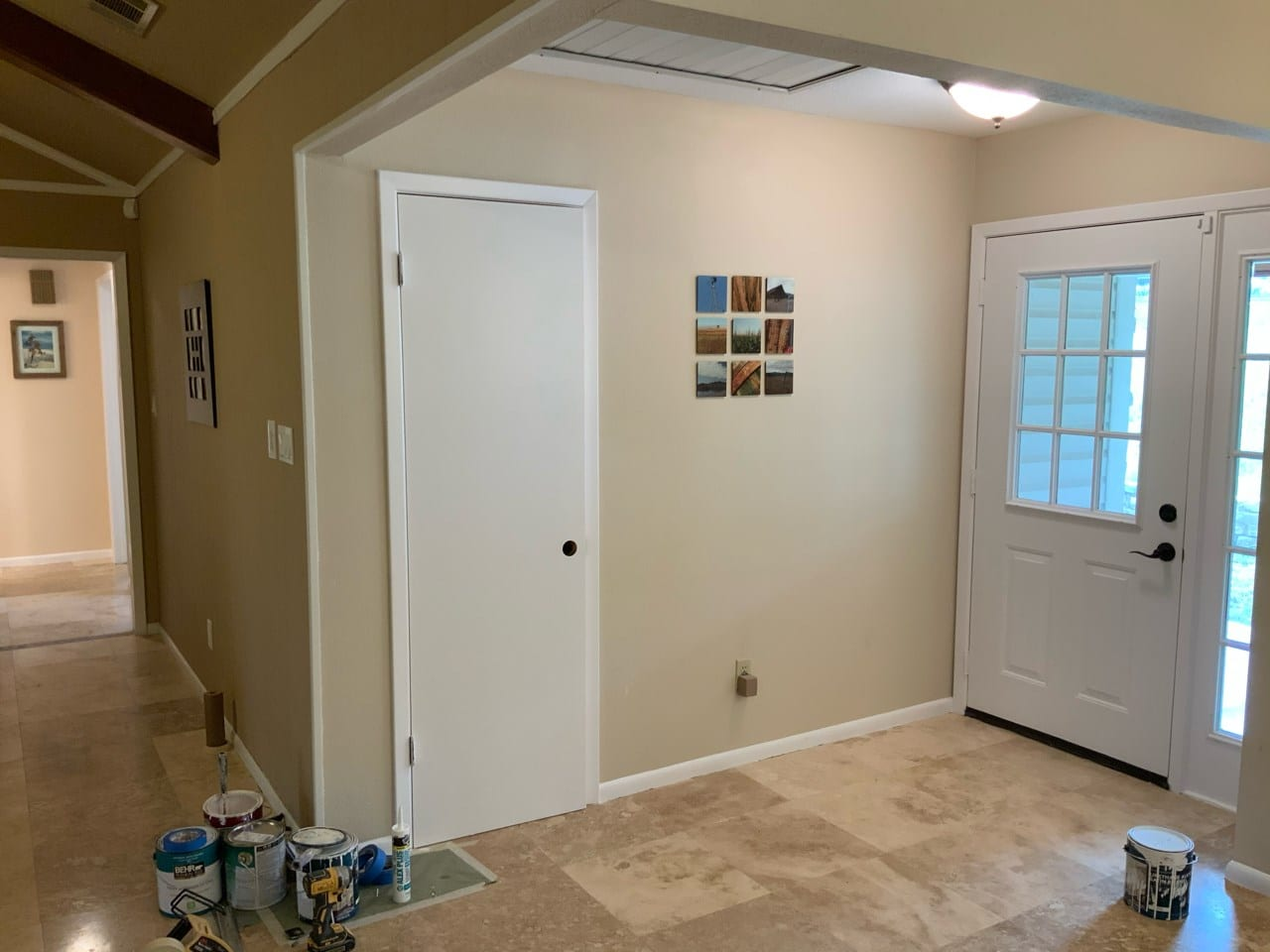 front entryway with painted trim and doors