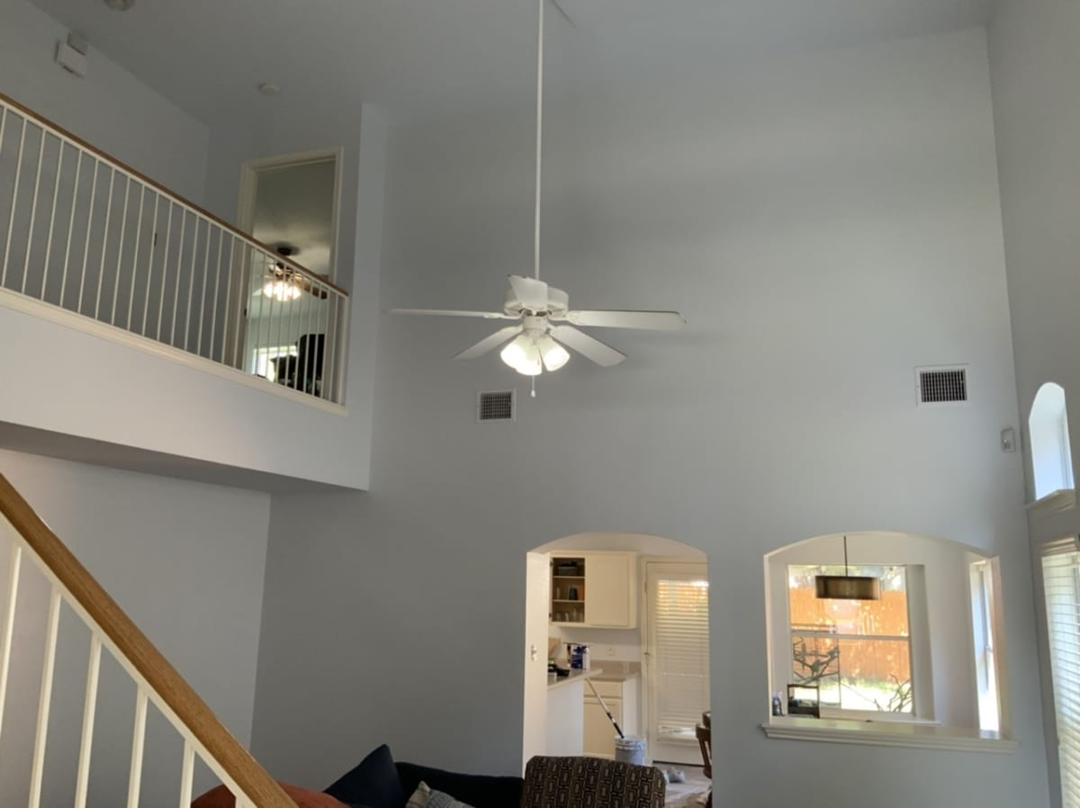 gray living room with vaulted ceiling