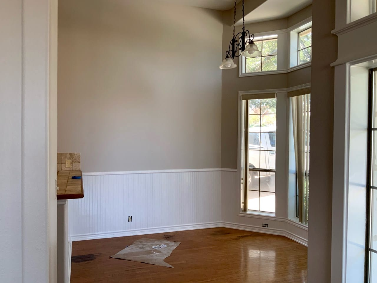 interior cathedral ceilings and wainscoting with wood floors