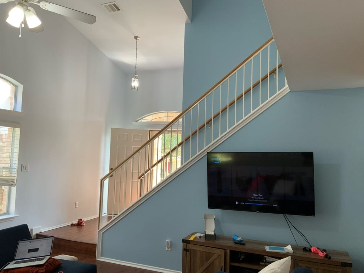 light blue accent wall on staircase