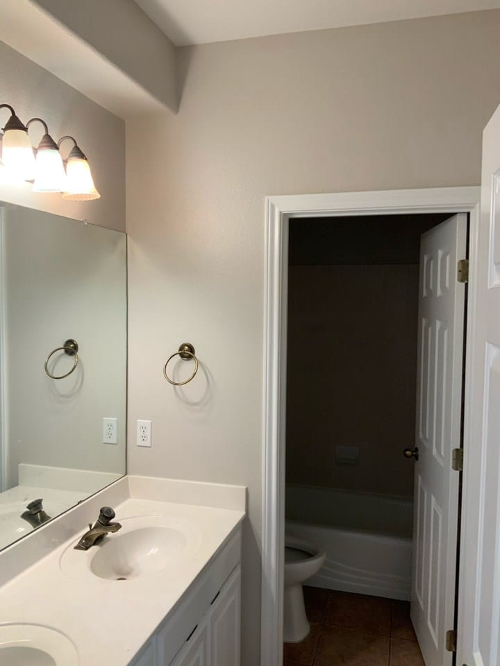 small bathroom with white cabinet