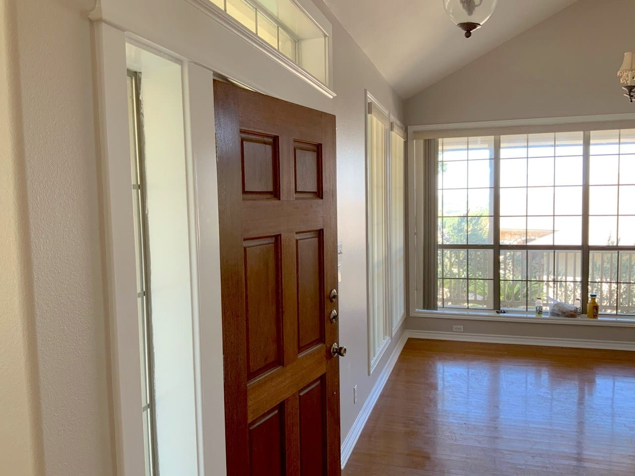 stained interior door and painted walls