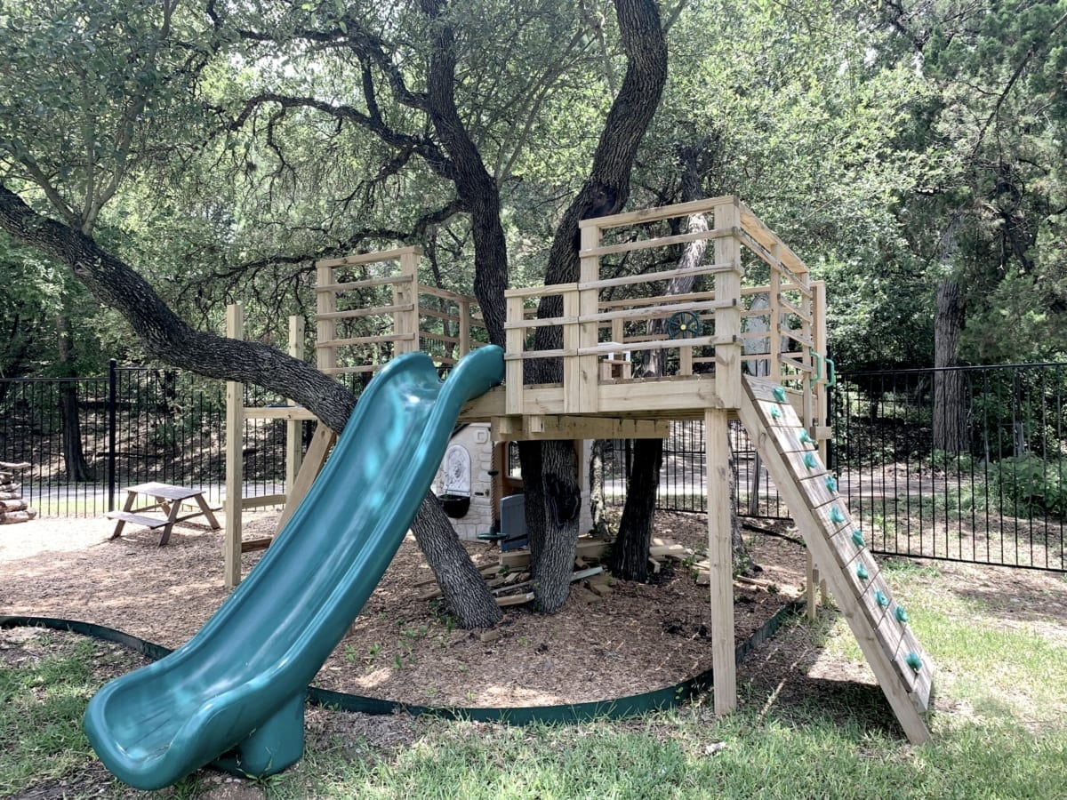 wood playscape before being re-stained