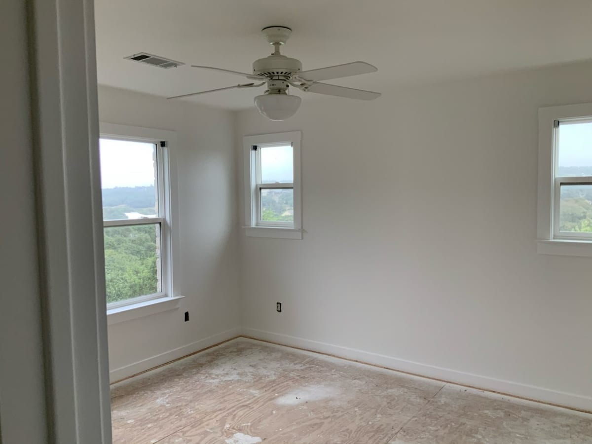 bedroom with new ceiling texture and white painted walls