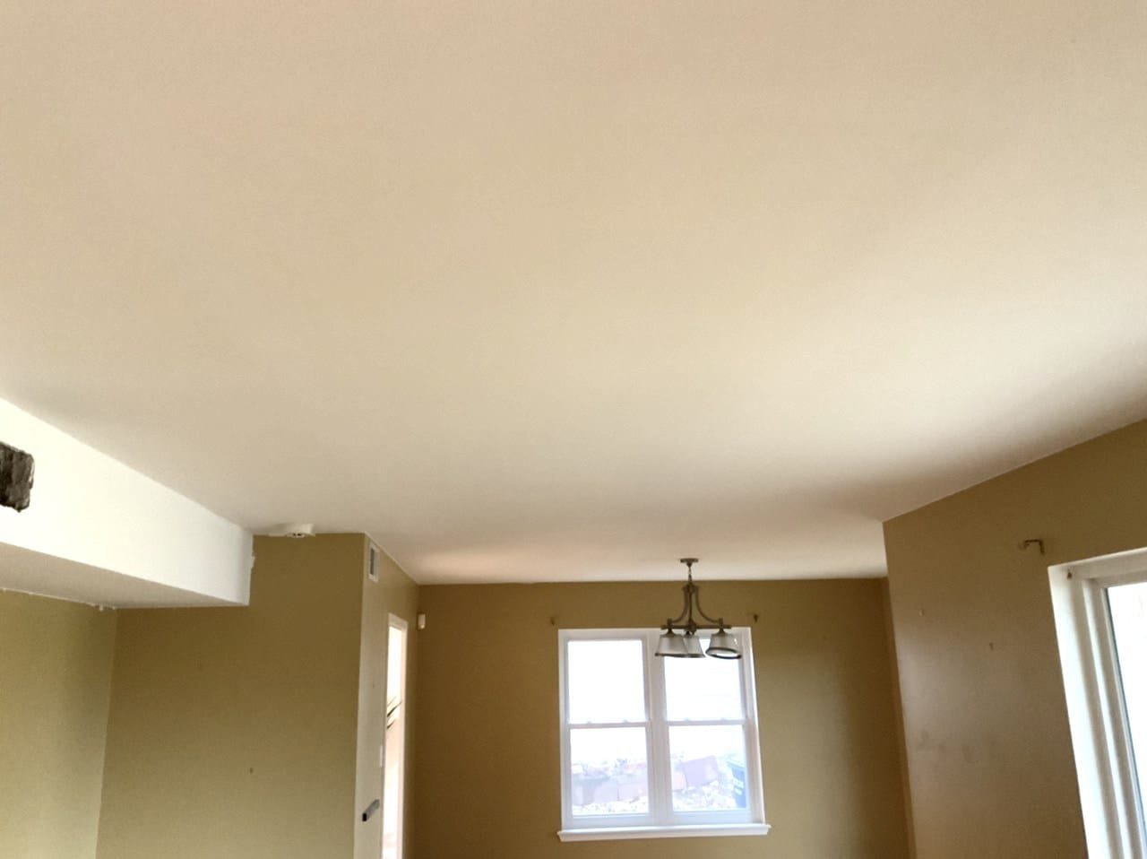ceiling after popcorn texture removal and painting