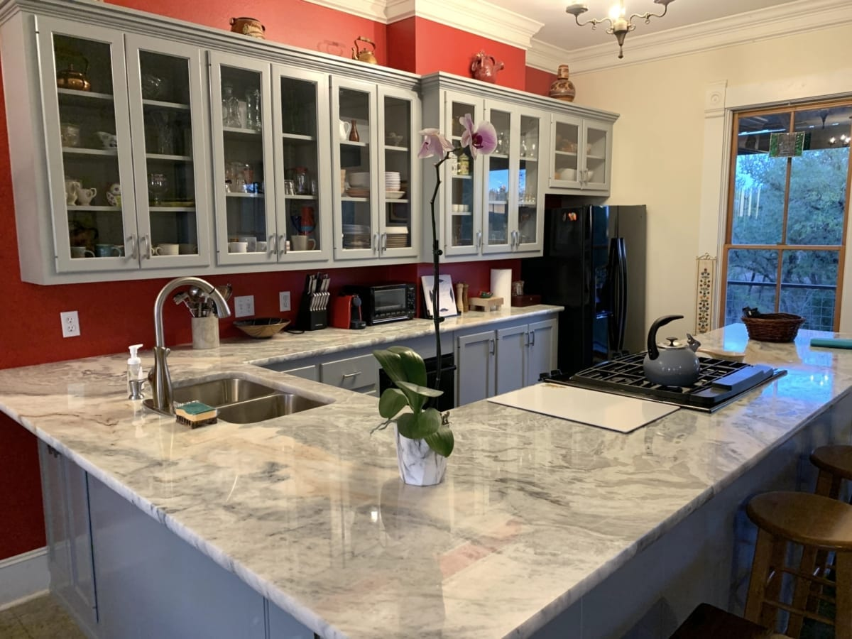 gray cabinet uppers in red kitchen