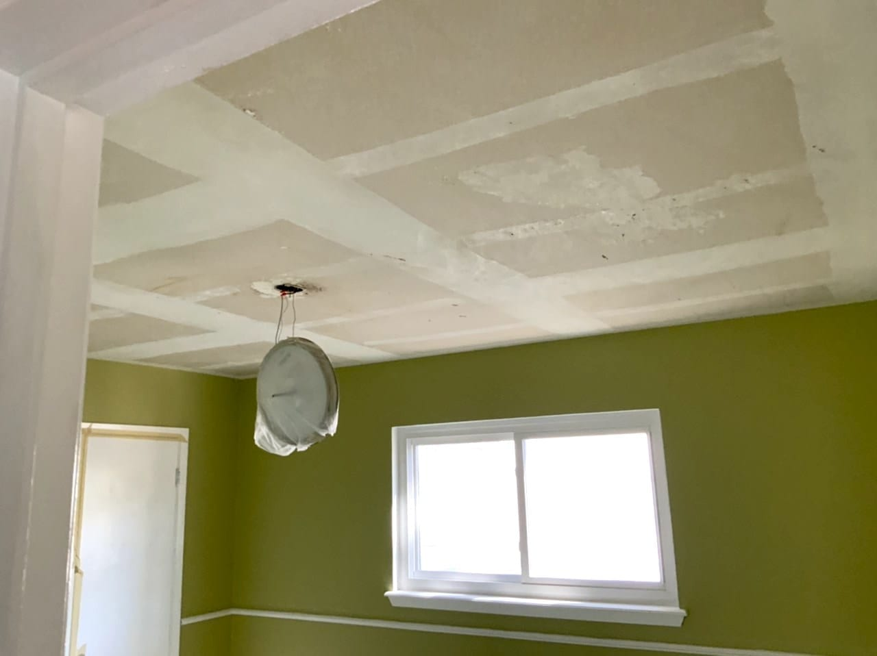 green bedroom ceiling after scraping