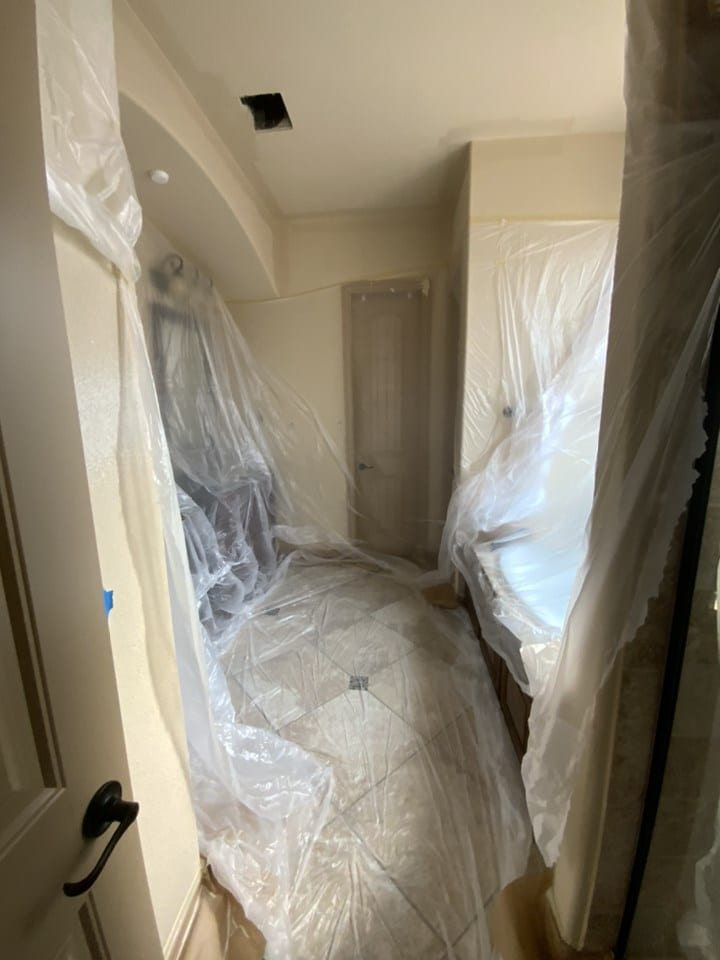 masked off bathroom for painting