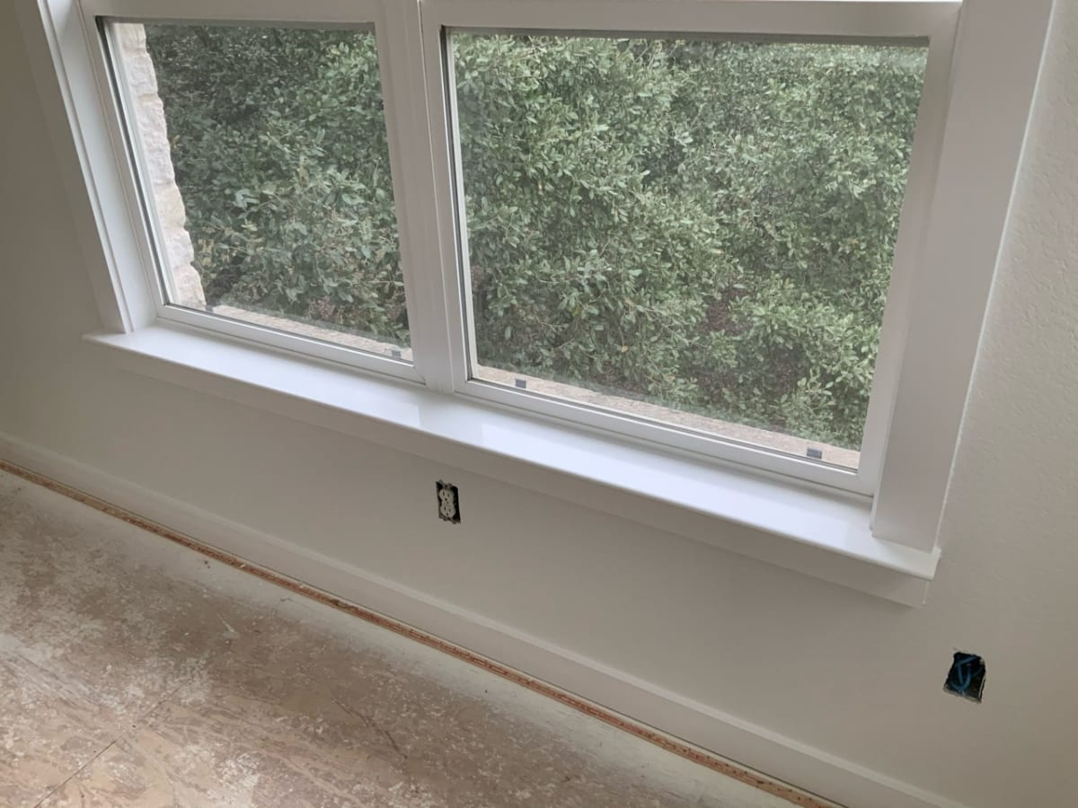 painted white window casing and window sill