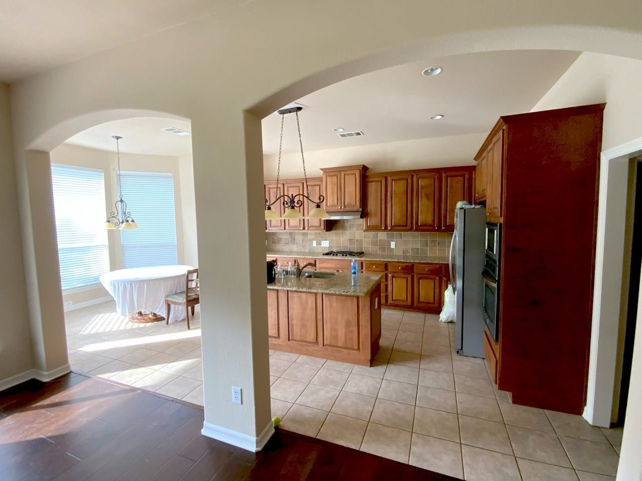 repainted kitchen with wood cabinets