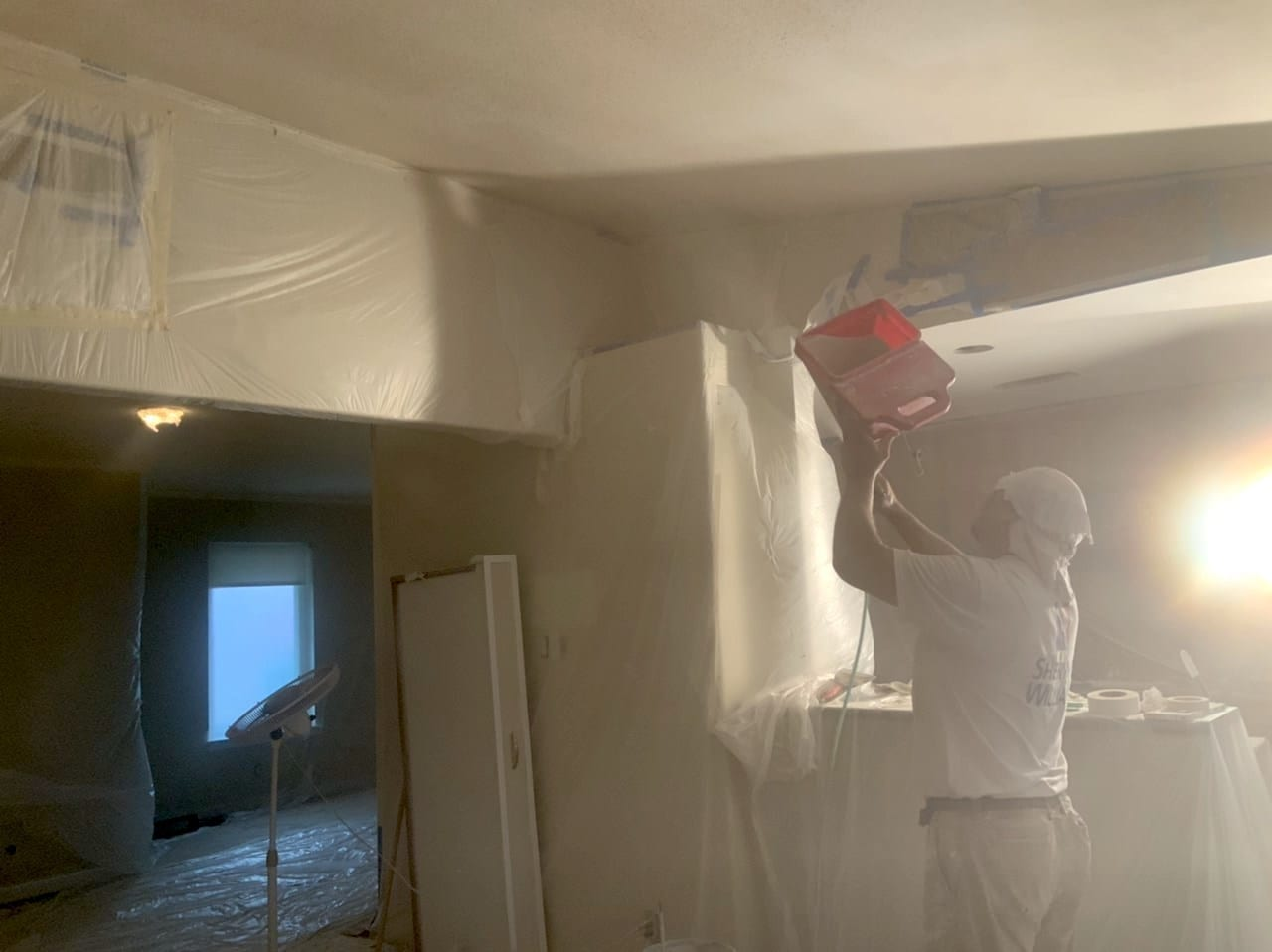 spraying texture onto ceilings