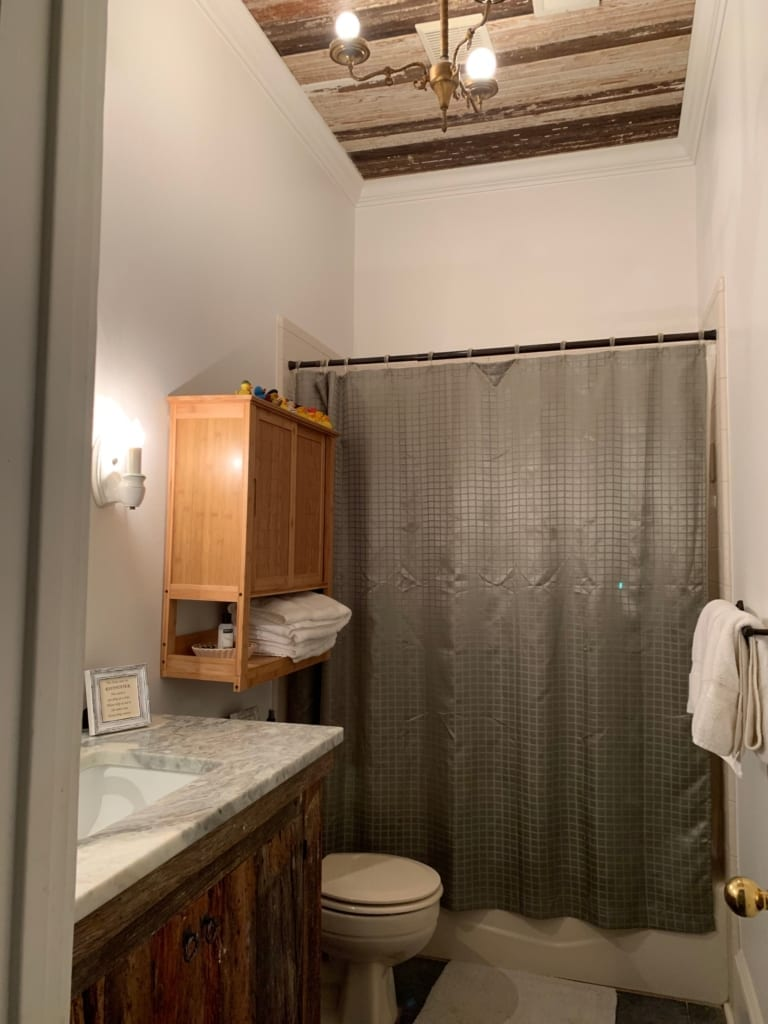 white bathroom with wood ceiling