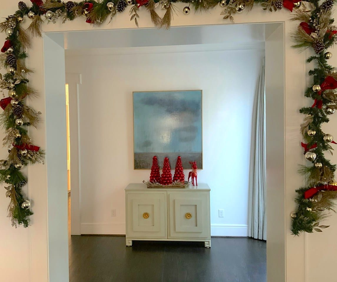white entryway with christmas decoration
