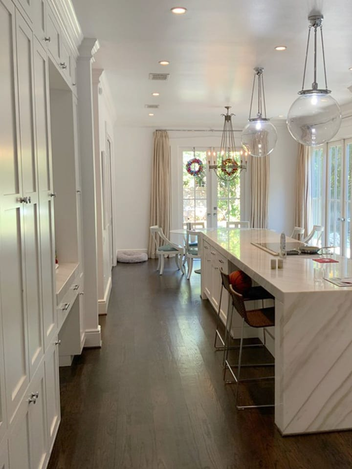 white kitchen cabinets and walls with dark wood floors