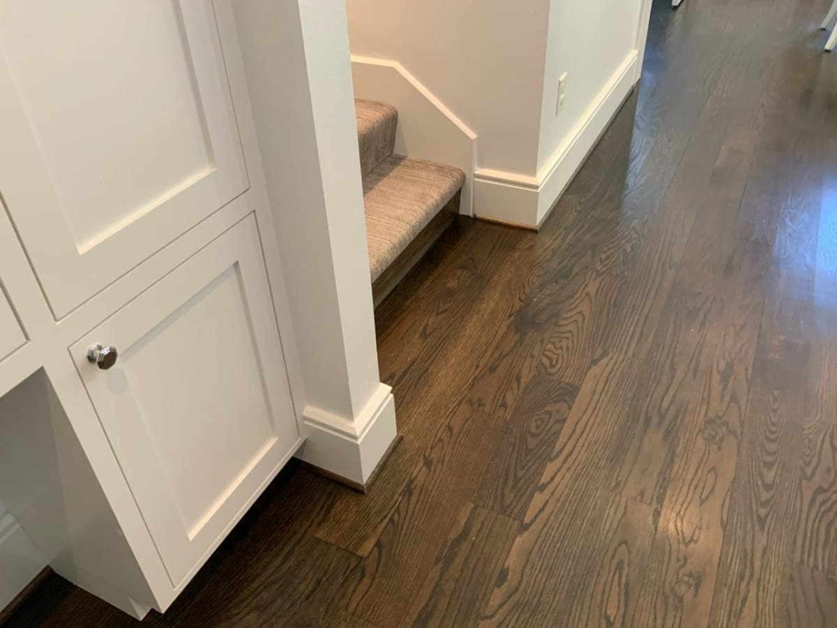 white trim and dark wood floors
