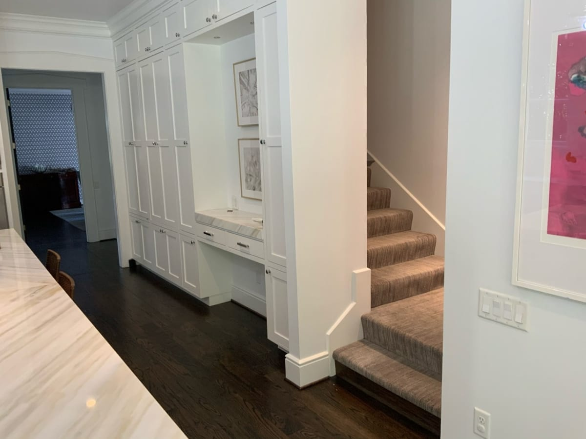 white walls and cabinets near staircase