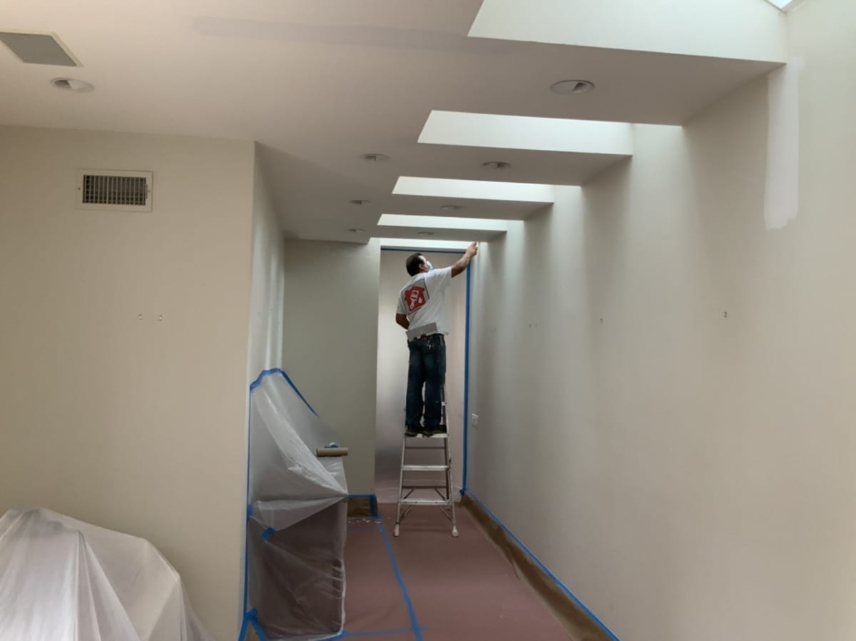 worker painting a hallway
